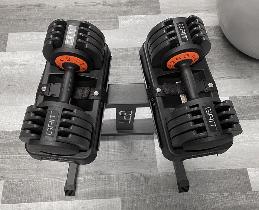 Black GRIT Dumbbell Stand with two 55lb Grit Adjustable Dumbbells